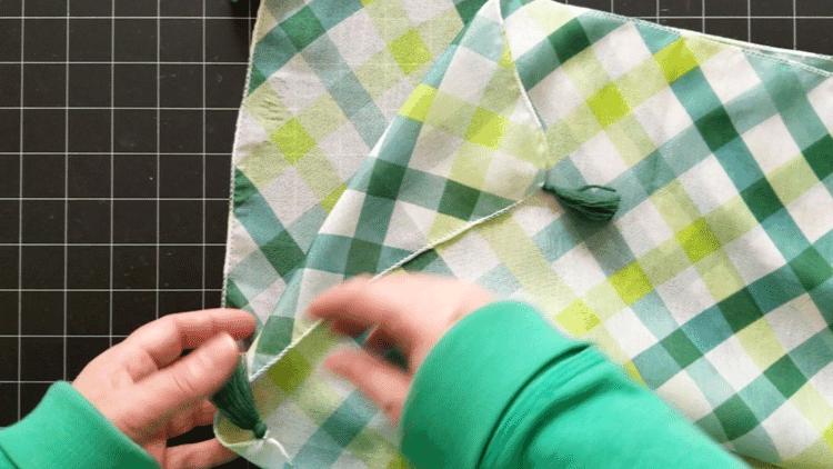 Folding the dollar store scarf in half.
