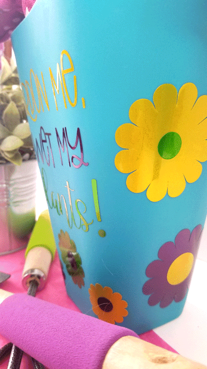 Adding vinyl text to the Dollar Tree watering can for a garden gift basket.