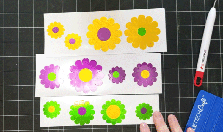 Flowers made with vinyl to add to a garden gift basket.