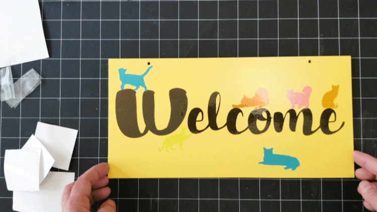 All of the cats added to the custom welcome sign.