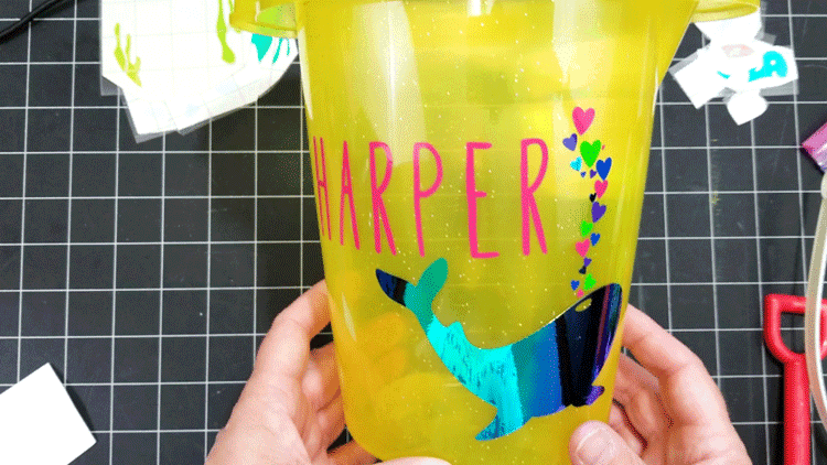 The finished sand bucket with Harper's name, the whale and the colorful hearts.