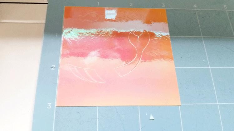 The Cricut Maker cutting the opal vinyl.