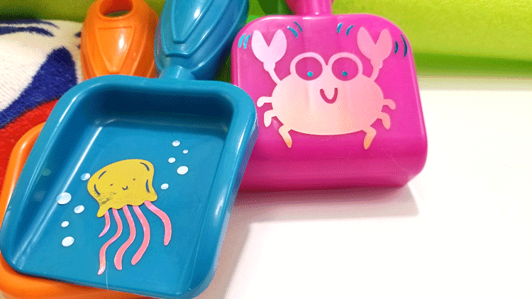 Finished sea creatures of multiple colors of vinyl on fun little sand and garden toys.