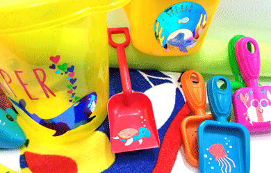 Finished multiple colored vinyl designs on all sorts of fun sand and water toys.