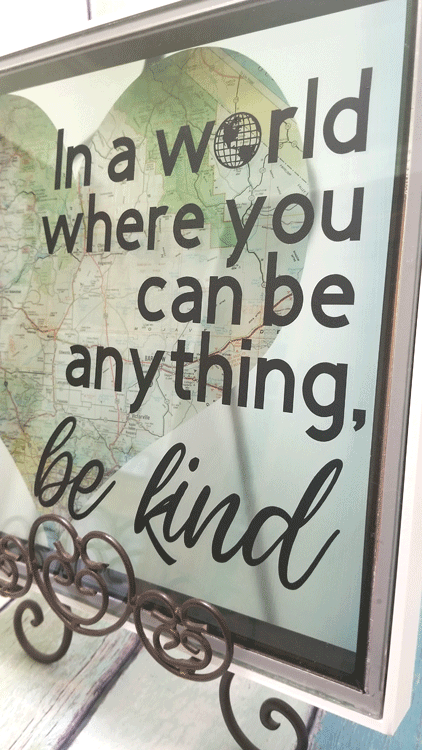 A close up view of the finished piece of diy kindness art displayed on an easel