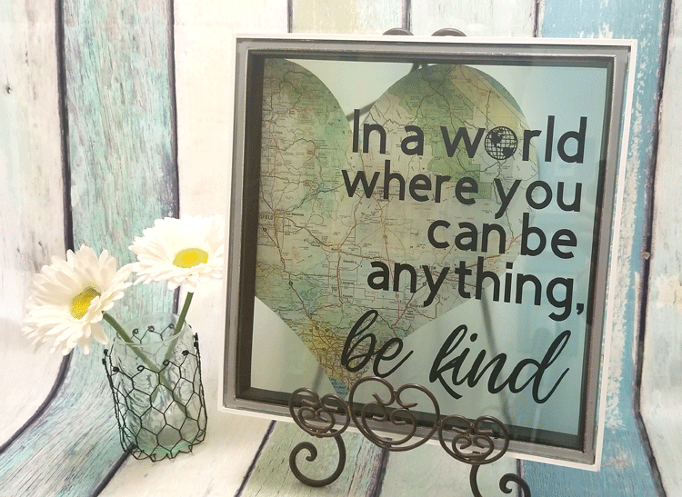 Finished piece of diy kindness art displayed on an easel