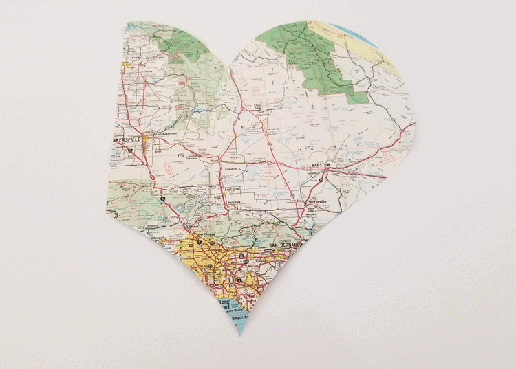 The map heart after it has been cut out using the Cricut. It has one straight edge on the left side.