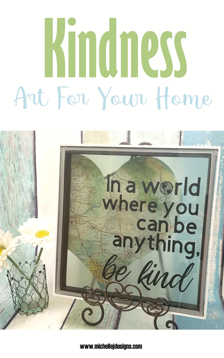 Finished piece of diy kindness art displayed on an easel.