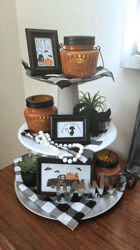 The finished tiered tray all decorated in  farmhouse Halloween decor.