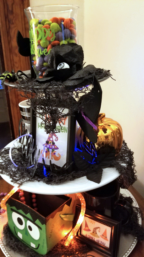 The finished tiered tray decked out with whimsical Halloween decor.