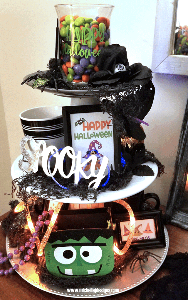 I created this DIY tiered tray and added some fun whimsical Halloween Decor.