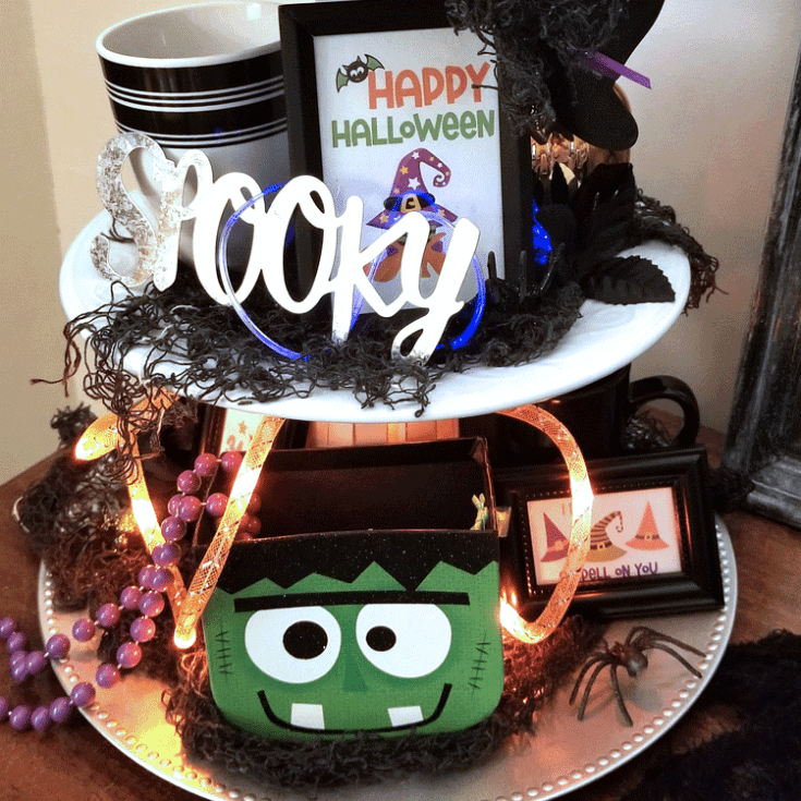The finished tiered tray with some fun Halloween decor.