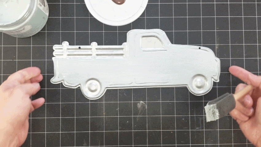 Painting the metal truck using a white wash painting technique using the Vintage color.