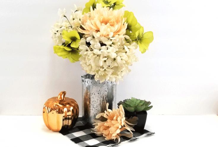 Finished DIY mercury glass look on a Dollar Tree vase.