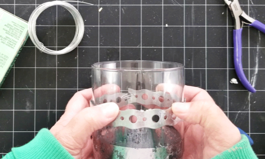 Sliding the metal band to cover the edge of the mercury glass look.