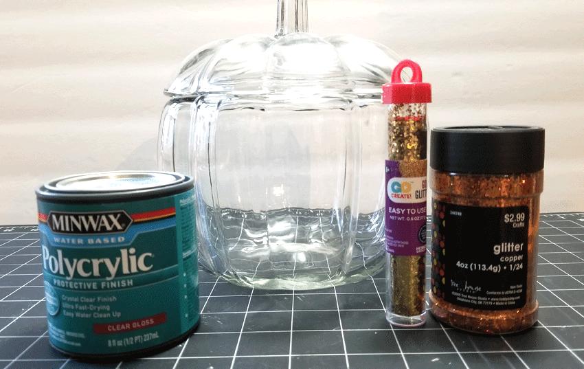 Supplies needed to make the glitter orange glass pumpkin