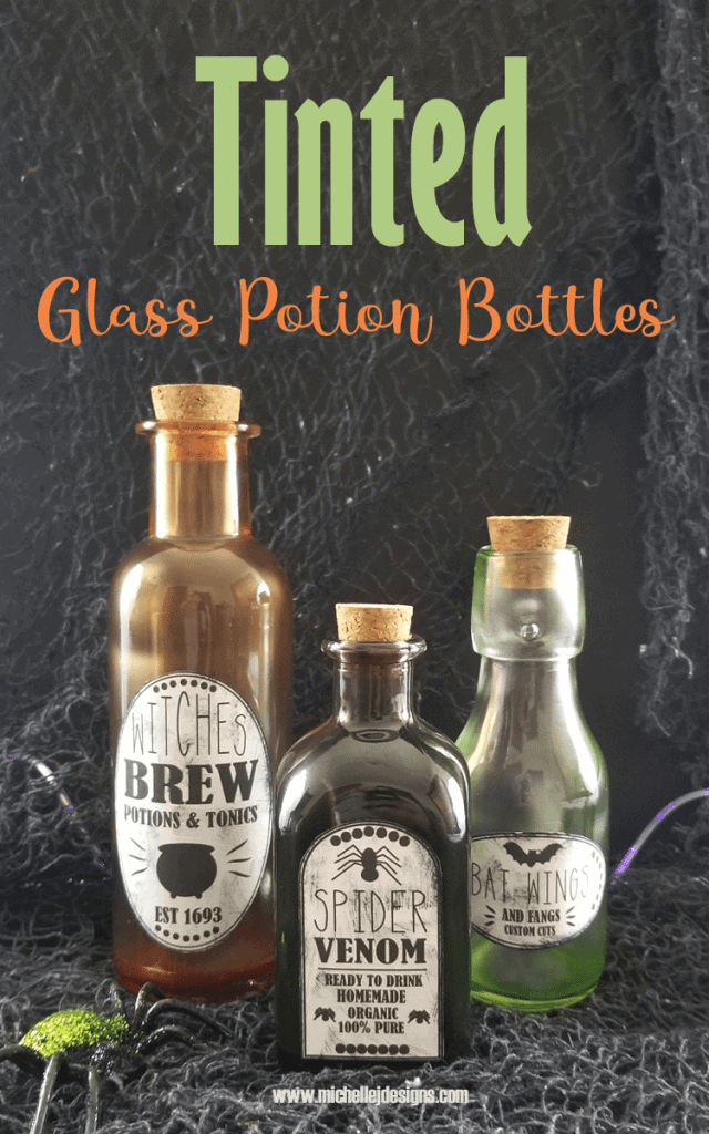 Three tinted glass potion bottles for Halloween.