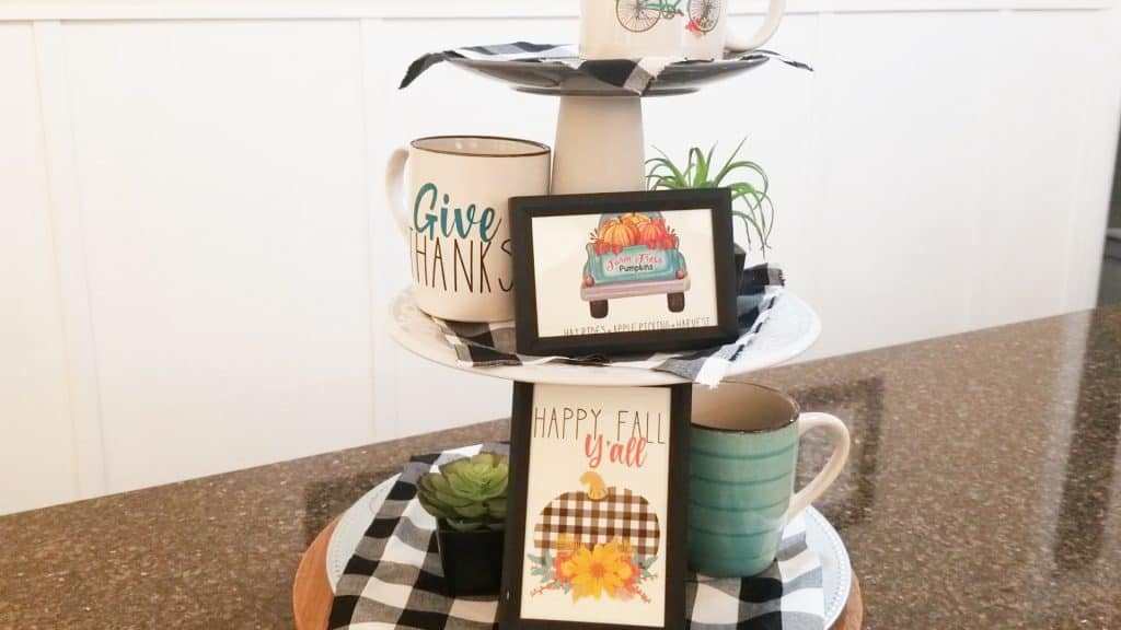 Adding more printables and the succulents to the tiers on the tray.