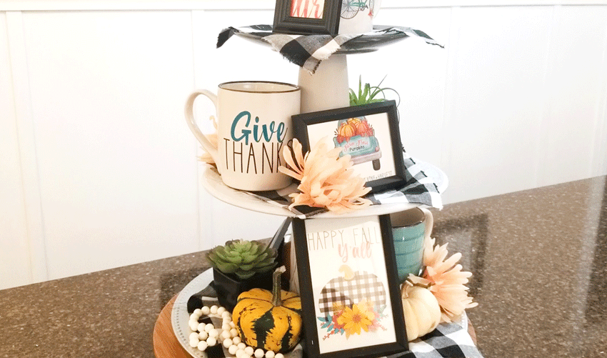 The finished tiered tray all cute decorated up for fall