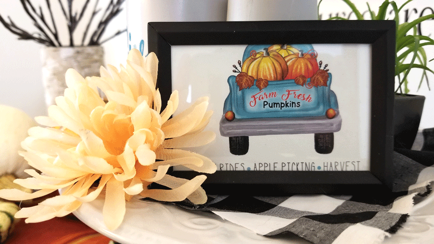 A close up view of the vintage truck farmhouse printable on the tray