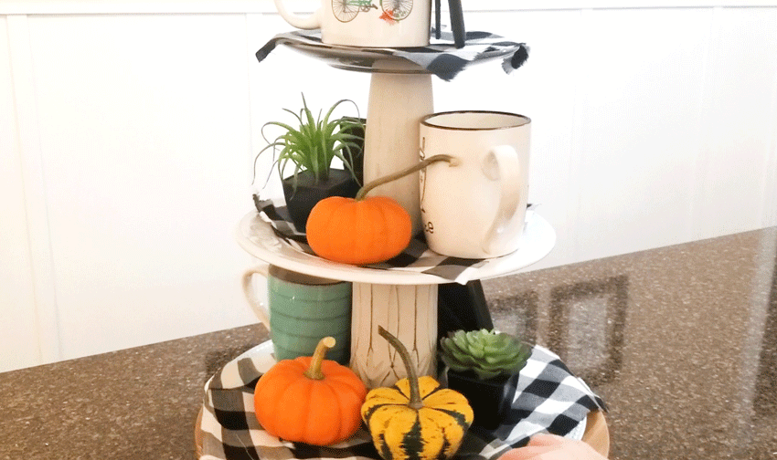 Adding pumpkins as filler to the back of the tiered tray