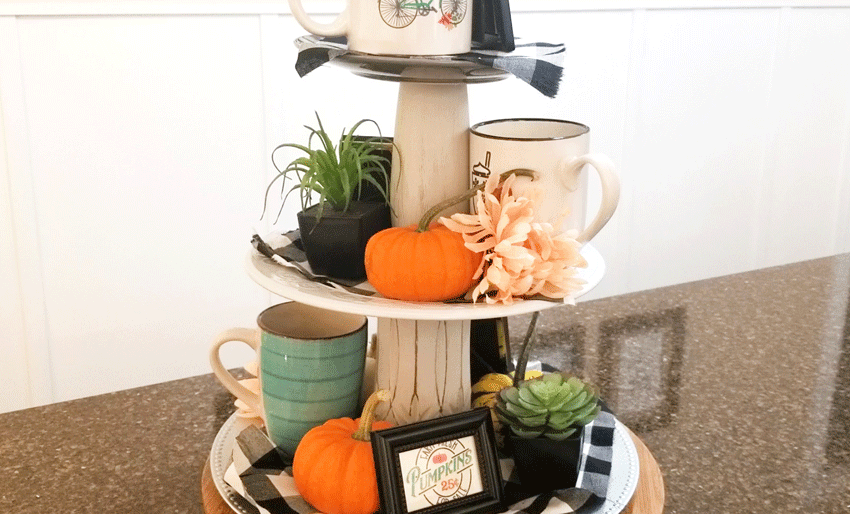 The back of the tiered tray with pumpkins and printables
