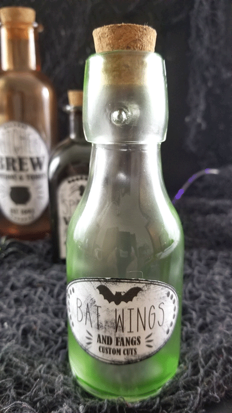 The green bottle up close with the grunged up label