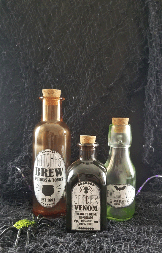 Potion labels and tinted glass bottles.  The finished authentic, spooky look