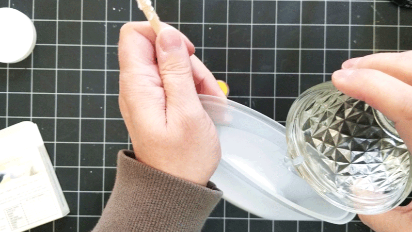 Mixing the water into the Mod Podge.