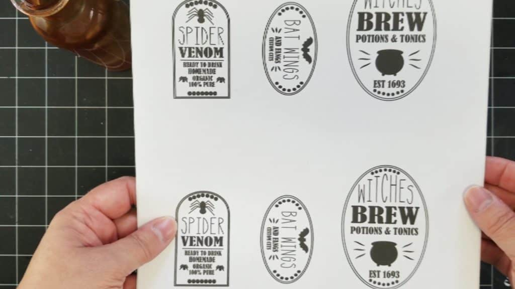 Free printable potion bottle labels printed onto sticker paper.