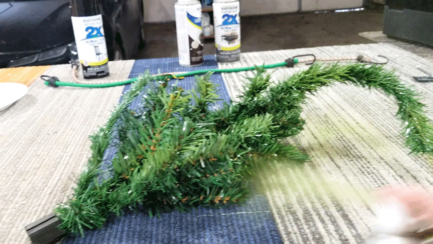 Adding Grinch green spray paint to the tree.