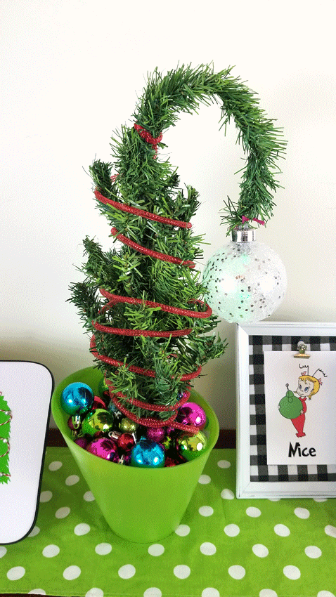 Finished Grinch Curved Tree with colorful ornaments at the base.