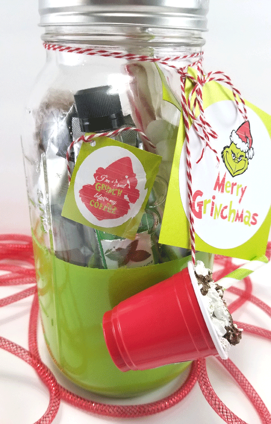 Finished Grinch Mason Jar Gift from the side view so all of the things inside can be seen