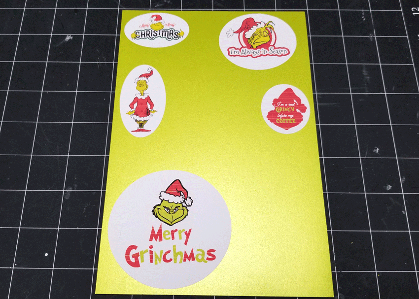 Printed Grinch designs placed onto green card stock