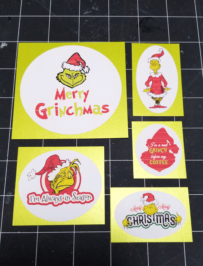 Cut tags from card stock and the printed Grinch designs