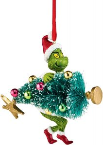 Dept 56 ornament of the Grinch stealing a Christmas tree.