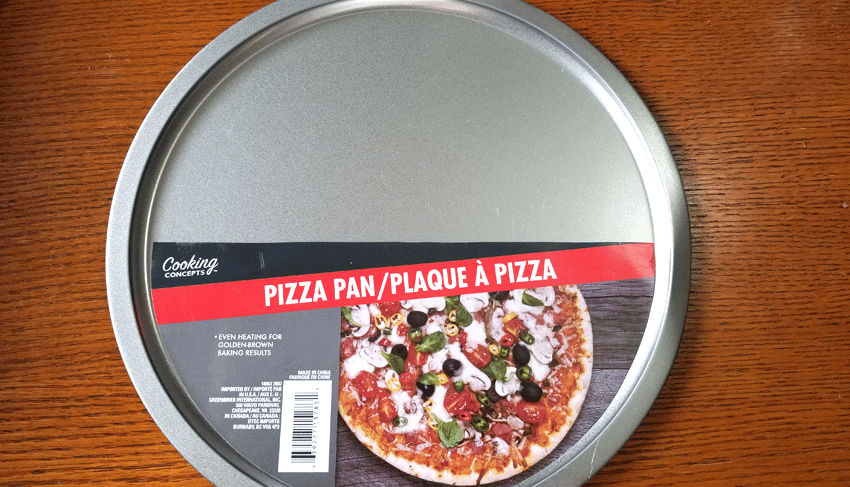 A dollar tree pizza pan is the base for this metal tray
