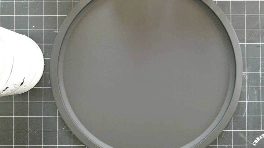 Black flat spray primer on the Dollar tree pizza pan.