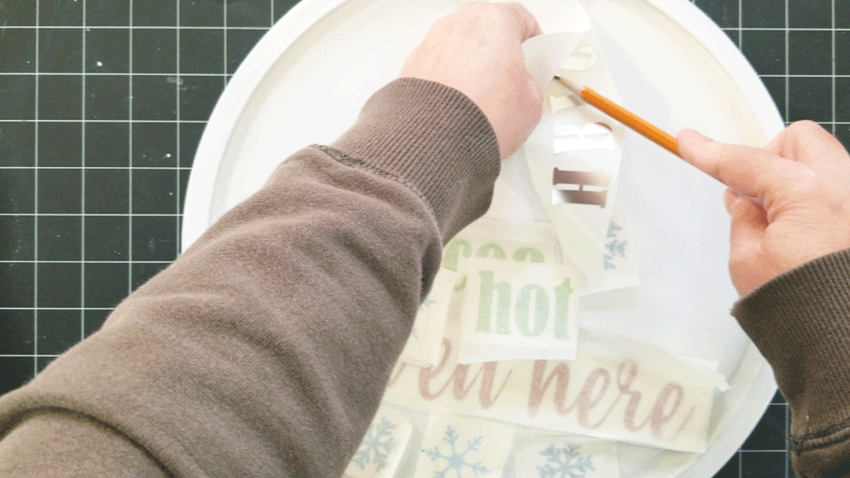 Using a pencil to help me get the vinyl letters away from the backing.