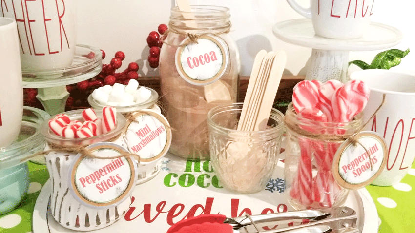 Finished glass jars with peppermint sticks and mini marshmallows