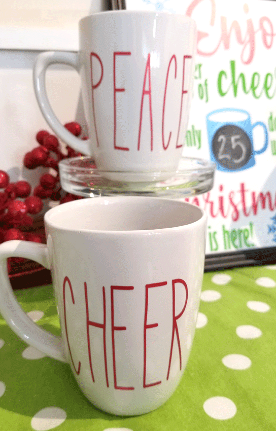 close up picture of Cheer mug and Peace mug with the countdown sign in the background