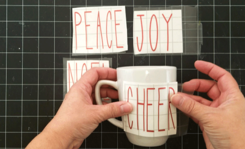 Adding the Rae Dunn inspired designs to the mugs.