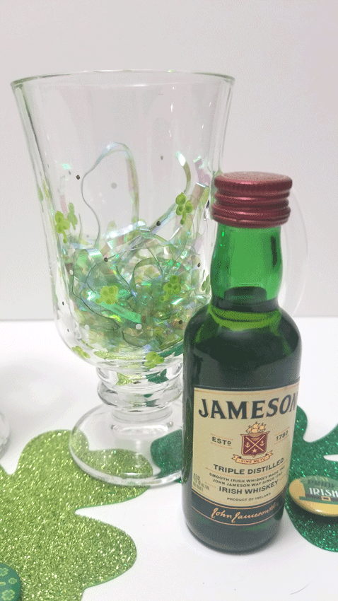 Adding the Jameson Irish whiskey and green Easter grass to the mug as a gift.