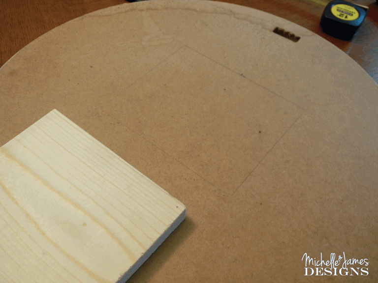 Placing a wood piece on the back of the mirror for the computer stand