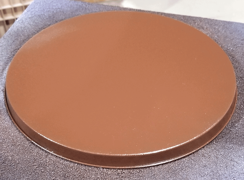 The bottom of the burner covers spray painted brown