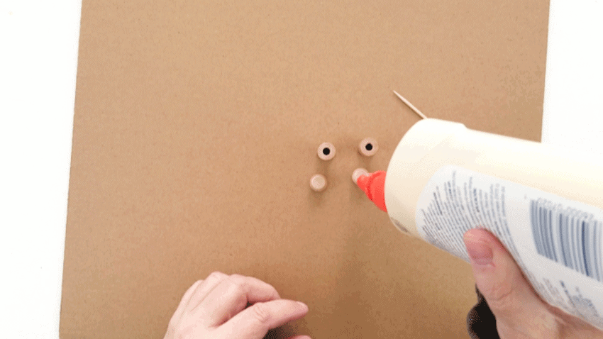 Adding wood glue to the bottom of the furniture button