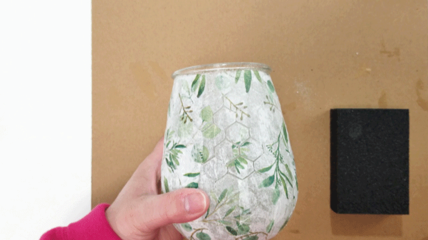 Sanding the tissue paper off of the raised chicken wire design of the glass.