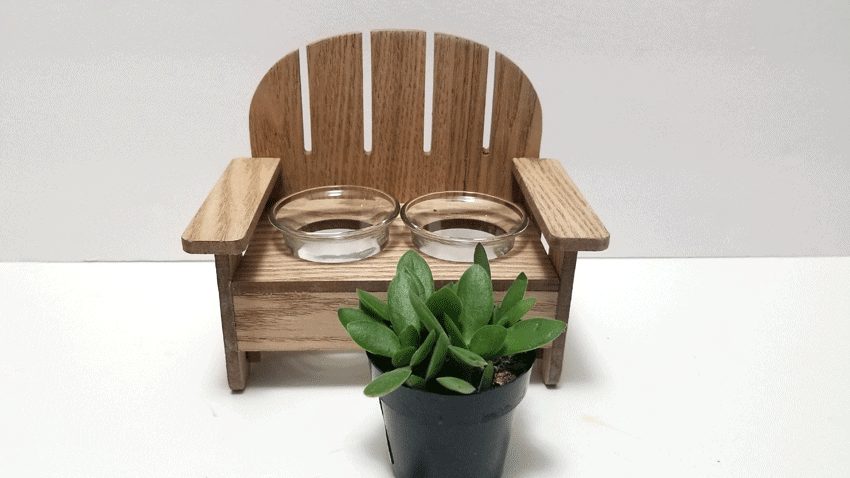 Wood small bench with glass votive holders and a small succulent plant