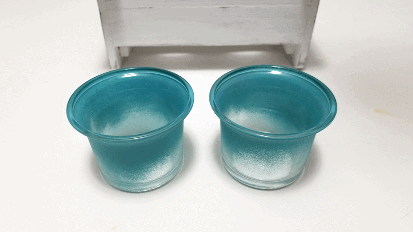 Glass votive candle holders spray painted with chalk paint on the outside.