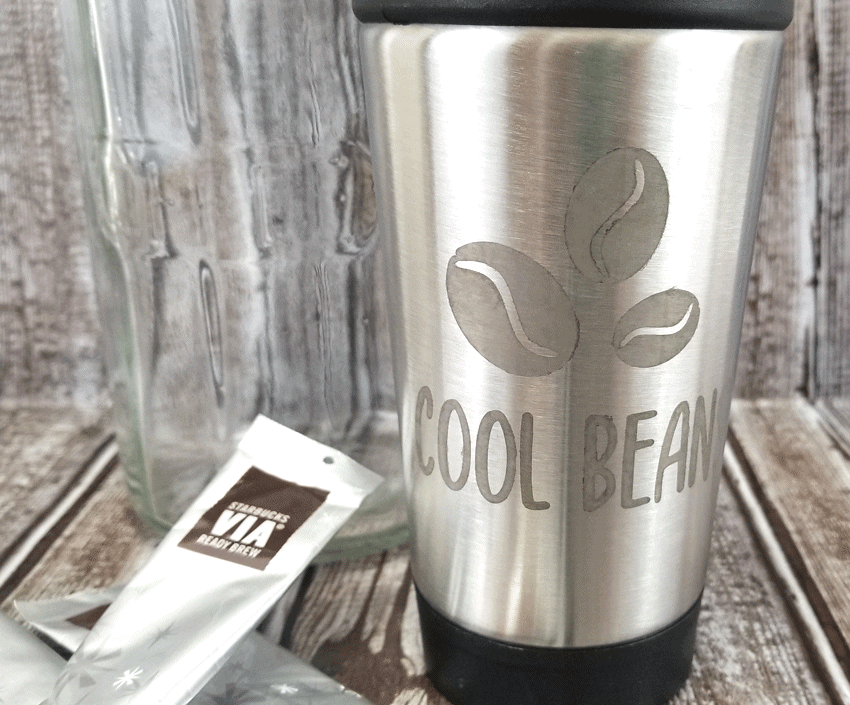 Finished etched metal coffee travel cup from the Dollar Tree.